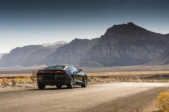 Black Sports Car on a Desert Road
