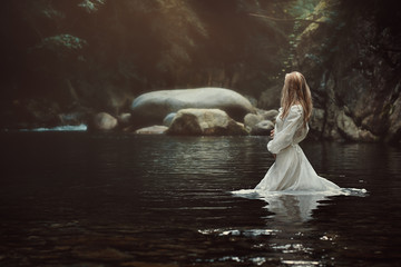 Beautiful woman in mystical stream