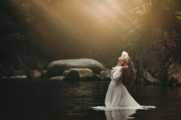 Young woman in fairy pond