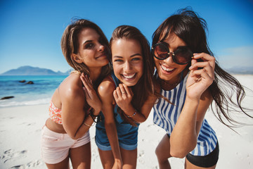 Female friends enjoying summer vacation on beach
