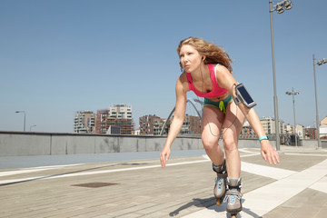 beautiful girl skating on roller skates in urban environment