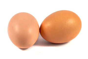 Two brown chicken eggs isolated on white
