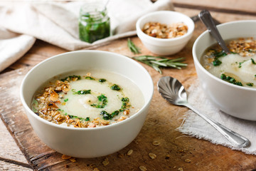 Celery cream soup with green oil and granola