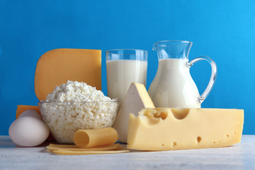 Set of fresh dairy products on color background