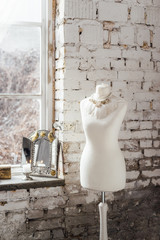 White mannequin in the workshop in the boho style
