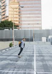Young man skateboarding.