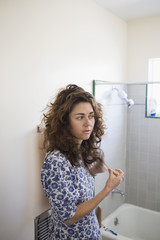 Young woman in a bathroom.
