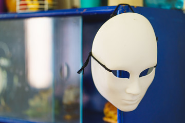 Theatrical mask hanging in the closet