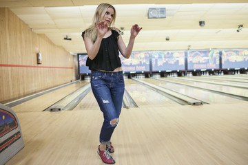A young woman at a bowling alley.