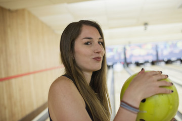 A young woman with a bowling ball.