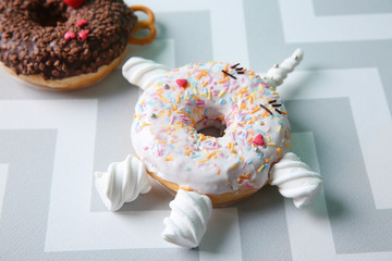 Creative donut on color background