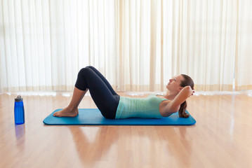 Female doing sit up abs exercise.