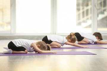 Foto auf Leinwand Gymnastik Group of children doing gymnastic exercises
