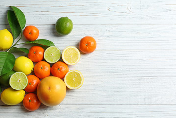 Beautiful composition of tropical fruits on wooden background