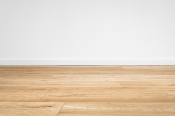 new wooden floor  - parquet floor and white wall background