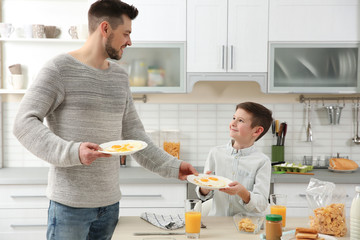 Dad and son preparing to have lunch at home
