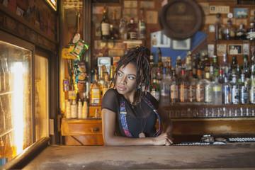 A young woman at a bar.