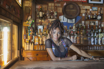 A young woman at a bar.