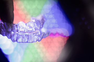 Invisible dental orthodontics on colored background