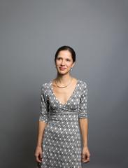 Studio portrait of a thoughtful woman