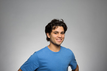 Studio portrait of an upbeat young man
