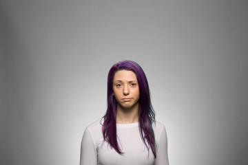 Studio portrait of a sad young woman