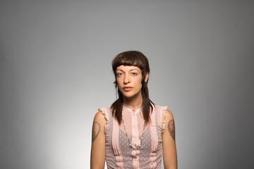 Studio portrait of a pensive woman