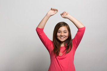 Studio portrait of an excited young girl