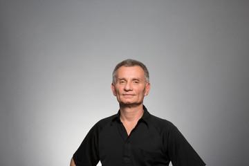 Studio portrait of a confident mature man