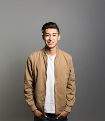 Studio portrait of a smiling young man
