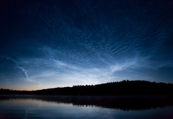 Noctilucent clouds at night