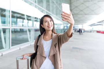 Woman go travel and taking selfie in Hong Kong airport