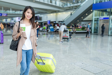 Woman go travel with luggage in Hong Kong international airport