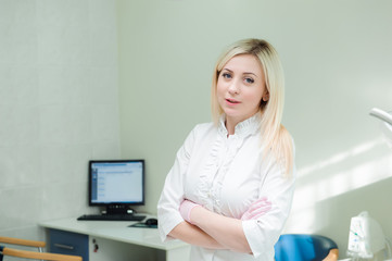 Portrait of a beautiful young woman doctor, dentist