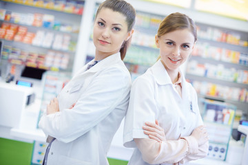 Two attractive pharmacists in pharmacy