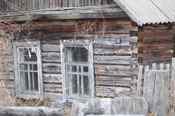 Decrepit wooden fence of the village house