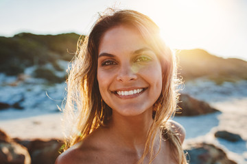 Smiling young woman on the beach