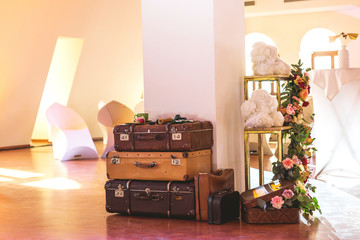 Vintage Pile of Ancient Suitcases. Design and travel concept