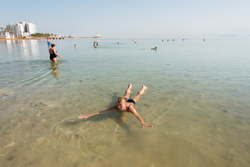Swimmers in Dead sea, Ein Bokek, Israel.