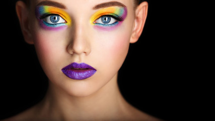 Wall Mural - Fashion model girl portrait with colorful powder make up. Beauty woman with bright color makeup. Close-up of Vogue style lady face, Abstract colourful make-up, Art design. Black background. copy space