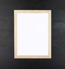 Brown wooden frame on black background.