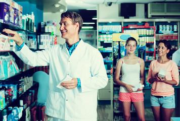 Man pharmacist in drug store