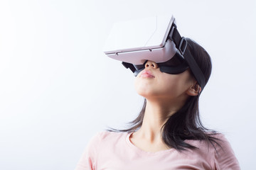Woman in VR headset looking up at the objects