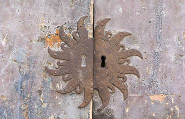 Aged rusty keyhole and wooden door