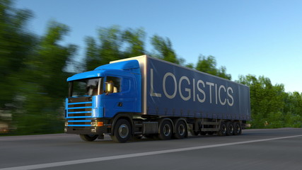 Speeding freight semi truck with LOGISTICS caption on the trailer. Road cargo transportation. 3D rendering