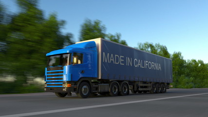Speeding freight semi truck with MADE IN CALIFORNIA caption on the trailer. Road cargo transportation. 3D rendering