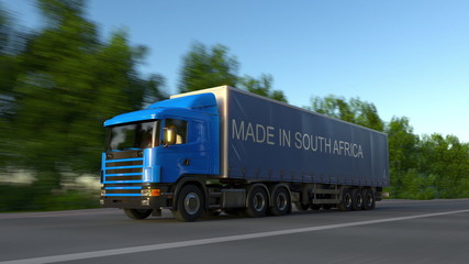 Speeding freight semi truck with MADE IN SOUTH AFRICA caption on the trailer. Road cargo transportation. 3D rendering