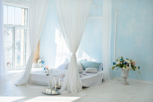 Interior white bedroom with canopy