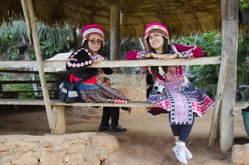 Thai mother and daughter wearing costume traditional of ethnic hmong for take photo in garden and visit Doi Pui Tribal Village and National Park