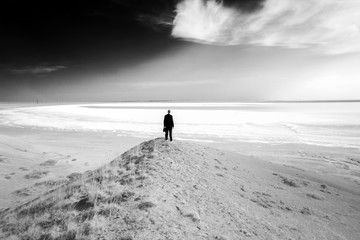 .Silhouette of man against the background of a salt lake